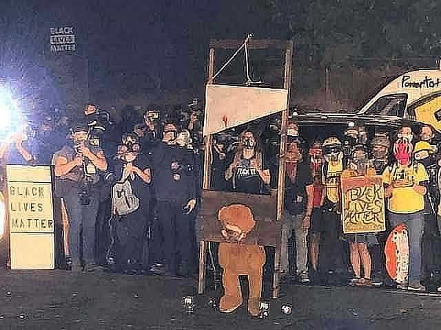 portland blm revolutionaries bring guillotine into suburbs where they burn american flags fling poo and demand shelter